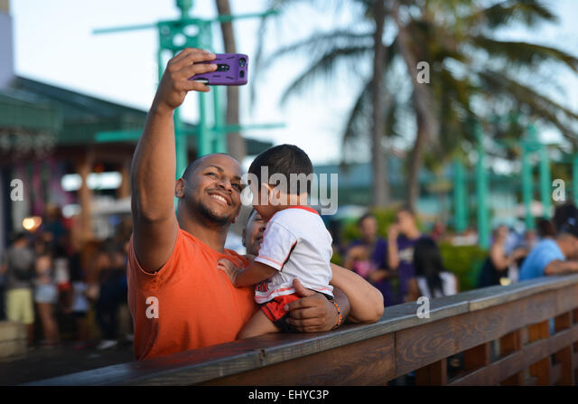 Family selfie. Father mother and son at La Guancha. Ponce, Puerto Rico. US territory. Caribbean Island. - Stock-Bilder