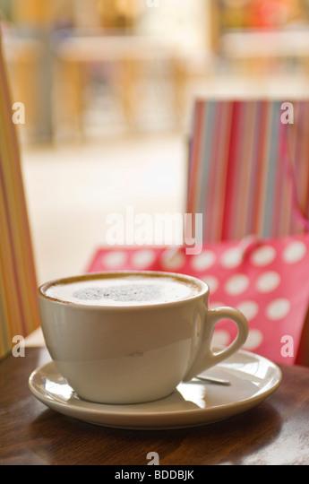 Concept coffee, shopping, bags, break at a shopping center. - Stock Image