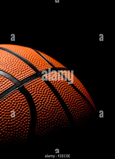 Single Basketball on a black background - Stock Image