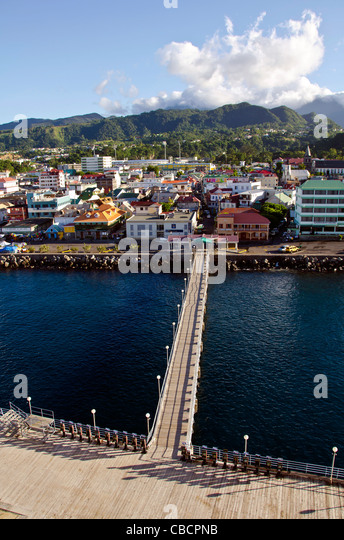 Roseau Dominica city overview above with cruise pier leading to shore - Stock Image
