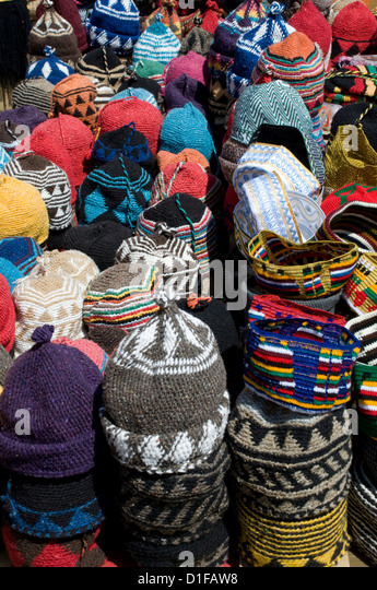 Brightly coloured knitted wool hats for sale in the souk in Marrakech, Morocco, North Africa, Africa - Stock Image