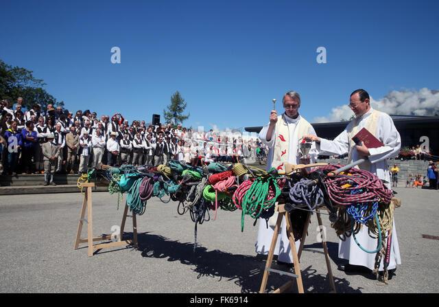 Priest blessing ice picks and ropes, Saint-Gervais mountain guides festival, Saint-Gervais-les-Bains, Haute Savoie, - Stock Image