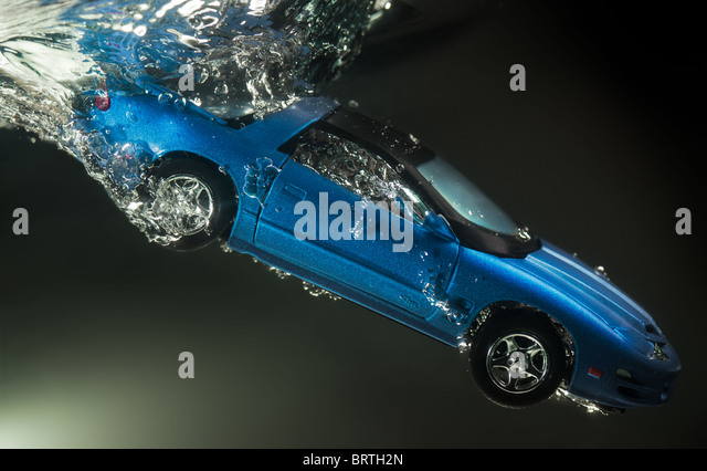 Toy car goes underwater - Stock Image