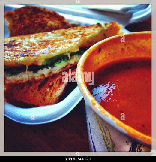 Lunch of a grilled cheese sandwich and a cup of tomato soup. - Stock Image