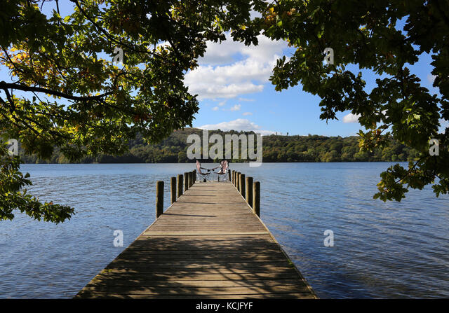 A relaxing spot on a jetty by Lake Windermere in the Lake District in Cumbria in the northwest of England in the - Stock Image