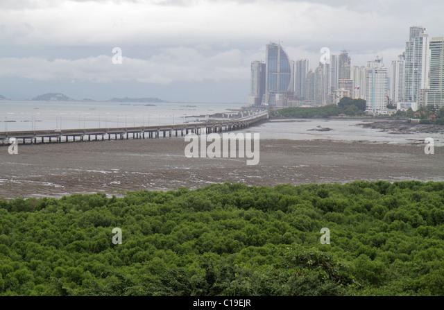 Panama Panama City Bahia de Panama Pacific Ocean Corredor Sur skyline skyscrapers modern city bridge coastal flats - Stock Image