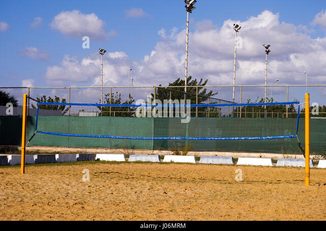 Volleyball net on sand court. - Stock Image