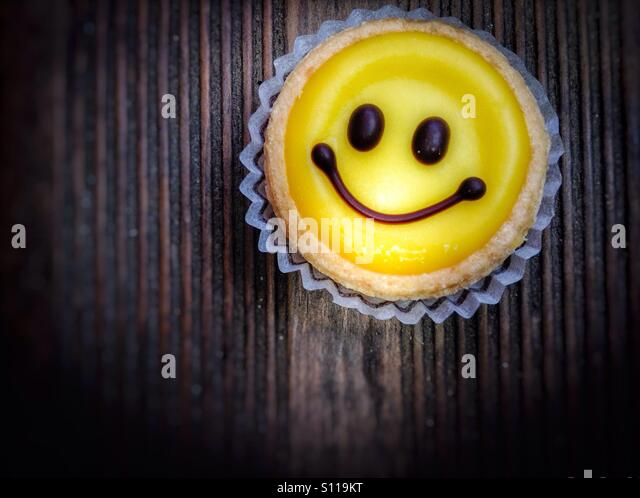 Smiley face home made lemon sweet - Stock Image