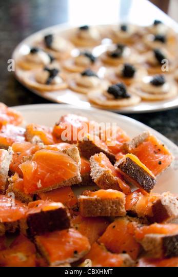 smoked salmon on bread and blinis with caviar, Christmas food UK - Stock Image