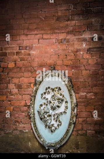 The two masks associated with drama represent the division between comedy and tragedy - Park Theatre, London - Stock Image