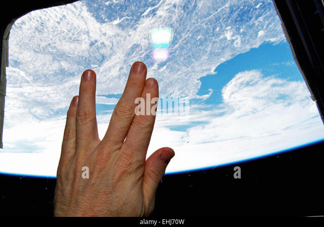 Astronaut Terry Virts (@AstroTerry) tweeted this image of a Vulcan hand salute from orbit as a tribute to actor - Stock Image
