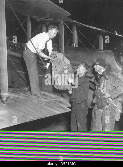 Photograph of airmail pilot Paul Collins and bag of first overnight airmail - Stock Image
