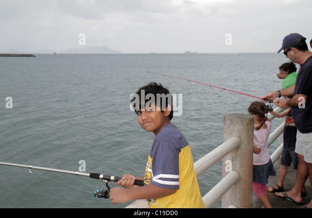 Panama City Panama Amador Causeway Calzada de Amador Bahia de Panama Panama Canal fishing pier rod reel sport Hispanic - Stock Image