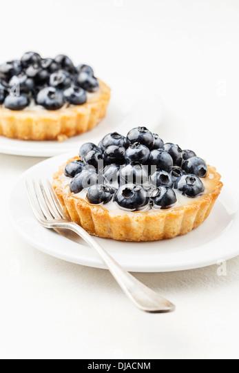 Blueberry tart on white background - Stock Image