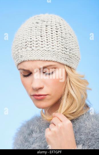 Beautiful woman touching her hair - Stock Image