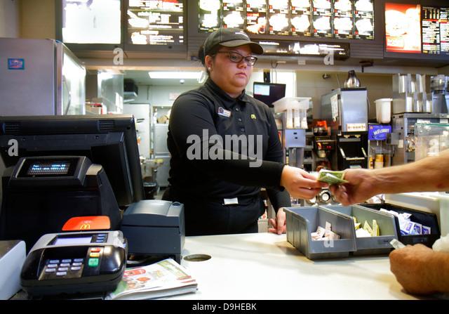 Nevada Las Vegas Walmart Wal-Mart Super Center centre shopping cashier Hispanic woman job McDonald's restaurant - Stock Image