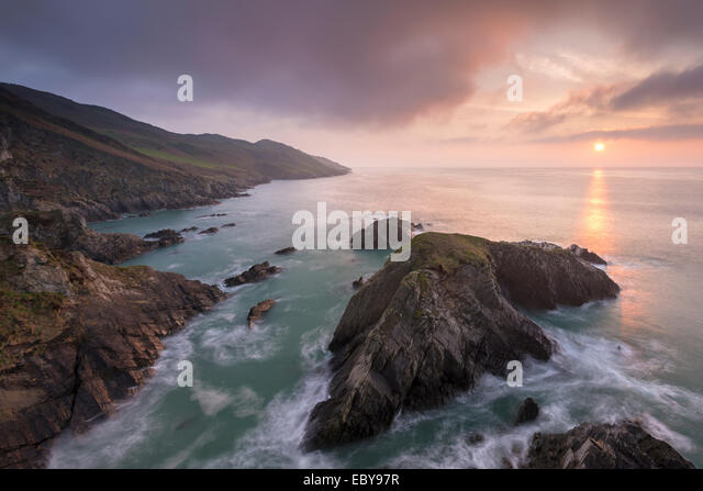 Sun setting over the North Devon coast, England. Spring (April) 2014. - Stock Image