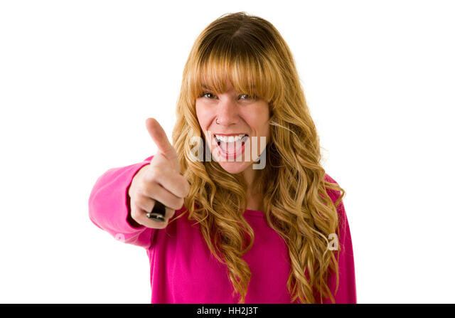 Happy blonde woman giving the thumbs up - Stock Image