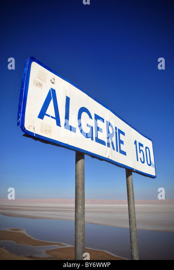 A roadsign on the way to Algeria near Tozeur, Tunisia - Stock Image