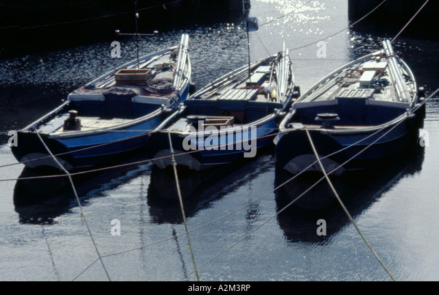 Coble fishing stock photos coble fishing stock images for How much does a fishing boat cost
