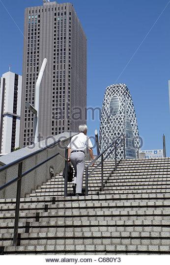 Japan Tokyo Shinjuku Shinjuku Center Building Mode Gakuen Cocoon Tower skyscrapers steps Asian man - Stock Image