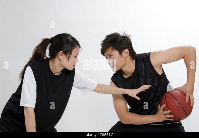 a couple basketball player - Stock Image