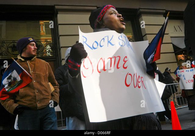 coalition of Haitian Americans and members of Local 1199, Health and Hospital Workers Union, protest against violent - Stock Image
