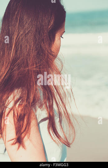 Historical young woman on the beach wearing a blue dress - Stock-Bilder