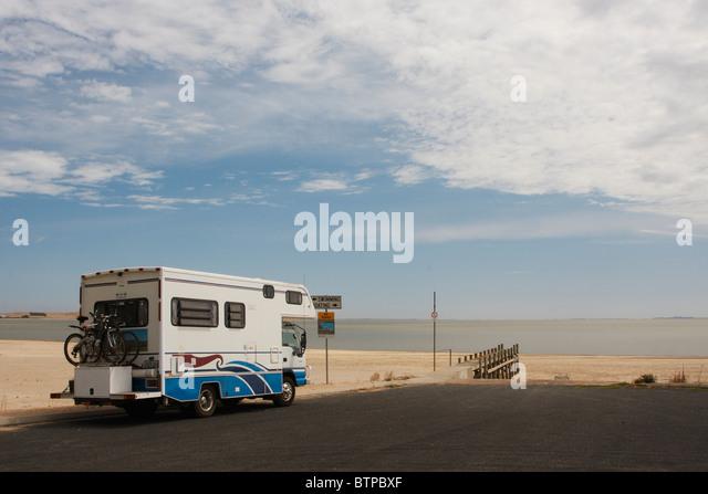 Australia, South Australia, Coorong, Meningie, Motorhome on road near beach - Stock Image