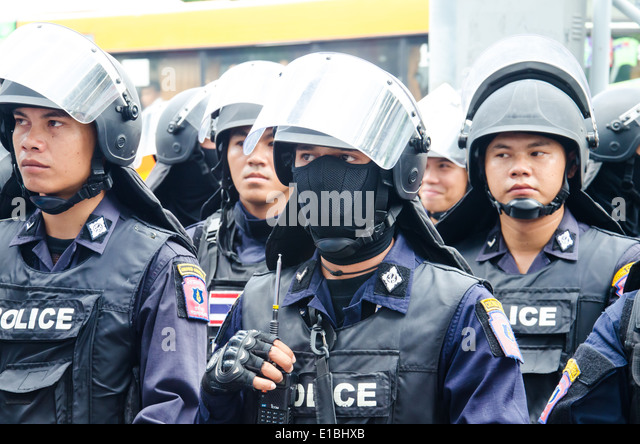 Riot police stand guard during a violent anti-Military coup - Stock Image