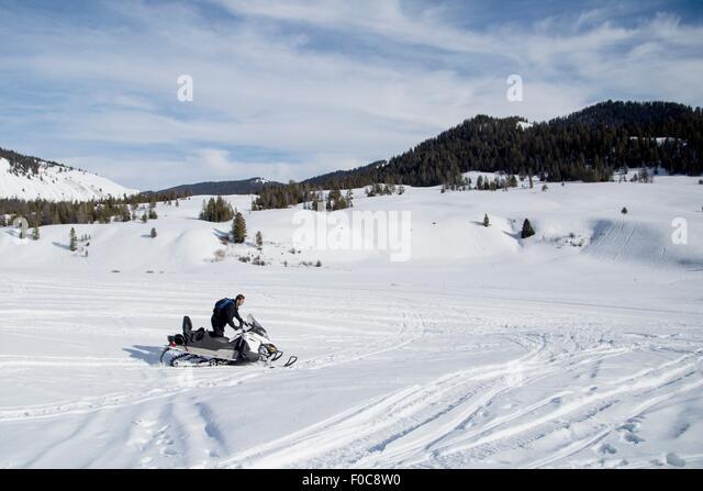 Man on snowmobile, Jackson Hole, Wyoming - Stock Image