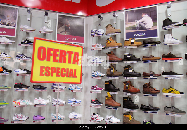 Nicaragua Managua Metrocentro shopping center mall business Sportline retail chain shoe store footwear display sign - Stock Image