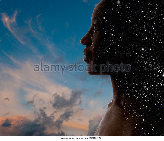 Black woman's face superimposed over sky - Stock Image