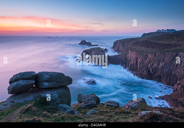 Land's End after sunset on a winter evening, Cornwall, England. Winter (February) 2013. - Stock Image