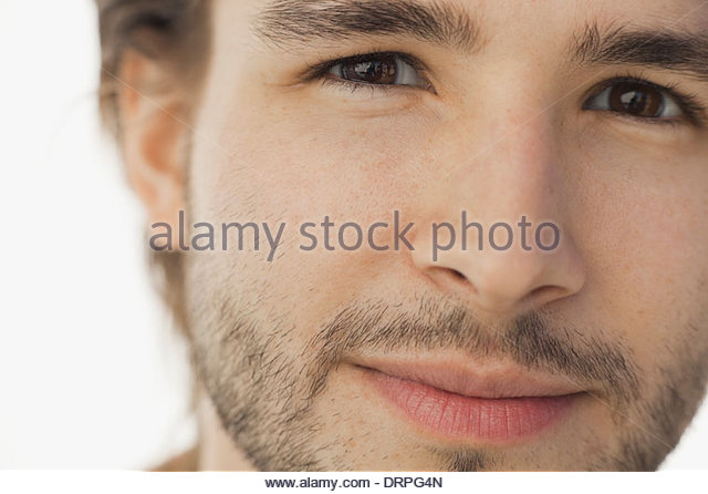 Close-up portrait of man looking at camera - Stock Image
