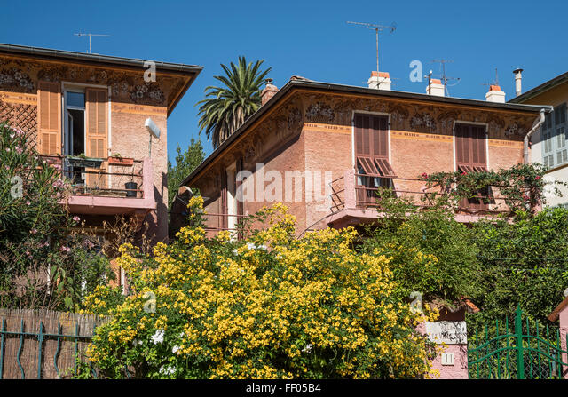 Balcony with flowers in Villefranche, Cote d Azur, France - Stock Image