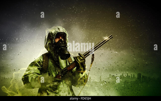 Image of stalker with gun. Ecology catastrophe - Stock Image