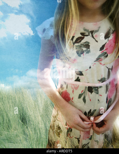 photo montage of a young girl wearing a dress - Stock-Bilder
