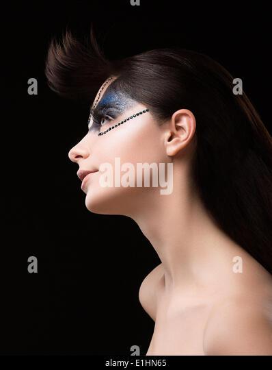 Haute Couture. Futuristic Brunette with Metallic Rhinestones. Fantastic Unusual Makeup - Stock Image