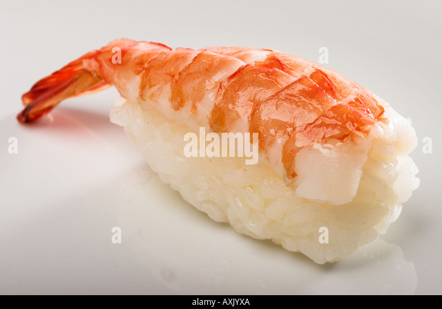 ebi sushi shrimp rice appetizer meal food consumption eat Asia orange white seafood tail - Stock Image