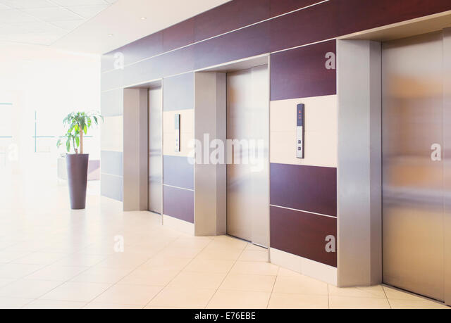 Elevators in modern building - Stock Image