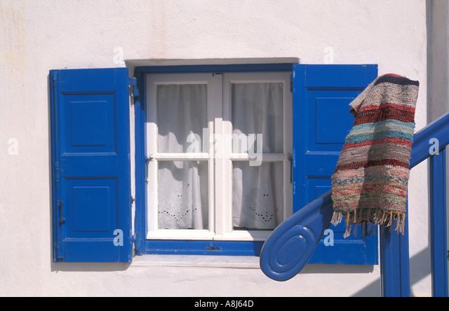 Greece Santornini window with blue shutters - Stock Image
