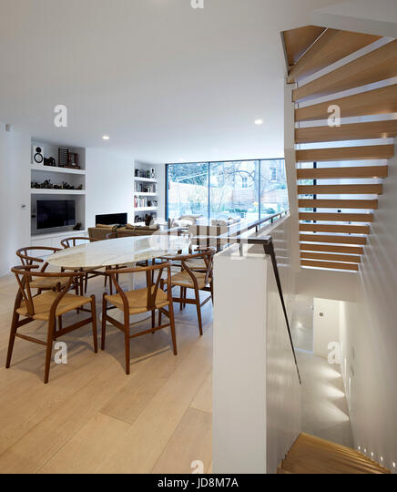 Overall view on ground floor showing stairs to basement. Notting Hill House, London, United Kingdom. Architect: - Stock-Bilder