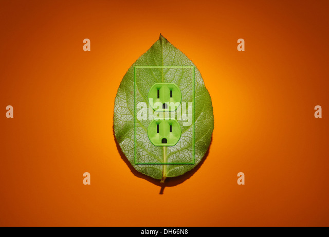 A green plant leaf with green colored electrical outlets added.Bright orange background - Stock Image