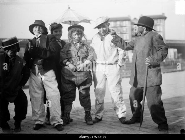 Halloween, children dressed in costumes, circa 1930s. - Stock Image