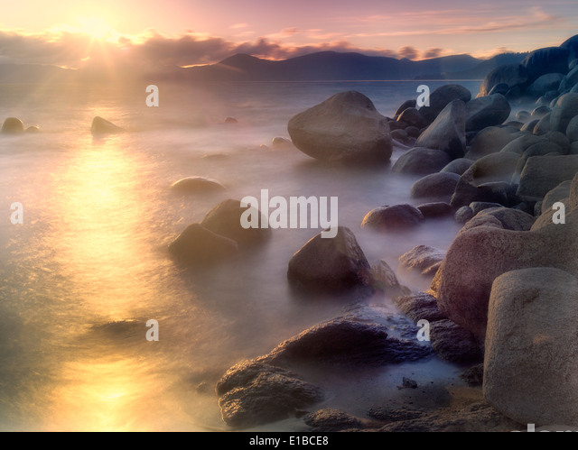 Sunset and rocks on Lake Tahoe. Sand Harbor State Park, Nevada - Stock Image