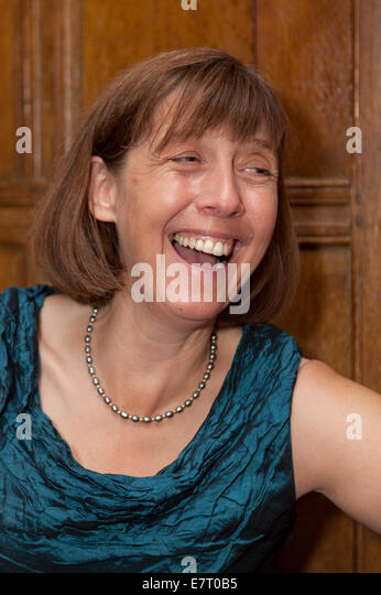 Happy middle aged woman, caucasian, age aged 50s laughing, UK - Stock Image