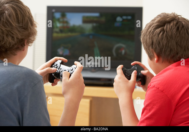 Two Boys Playing With Game Console - Stock Image