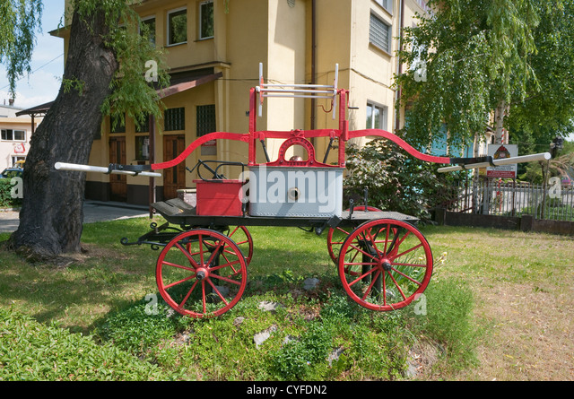 Vintage firefighting pump at the front of Fire Station in Wadowice, Poland. - Stock Image