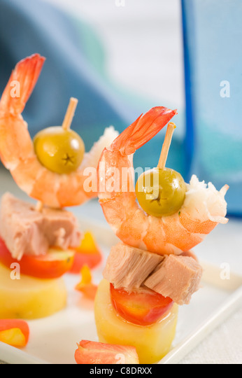Tuna,tomato,potato and shrimp mini skewers - Stock Image